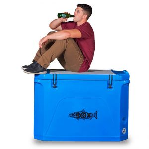 Man drinking and sitting on blue Fishbox.